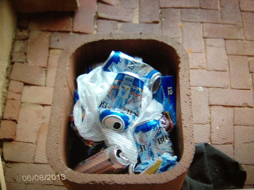 The museum reports finding beer cans all over and inside cigarette trash cans