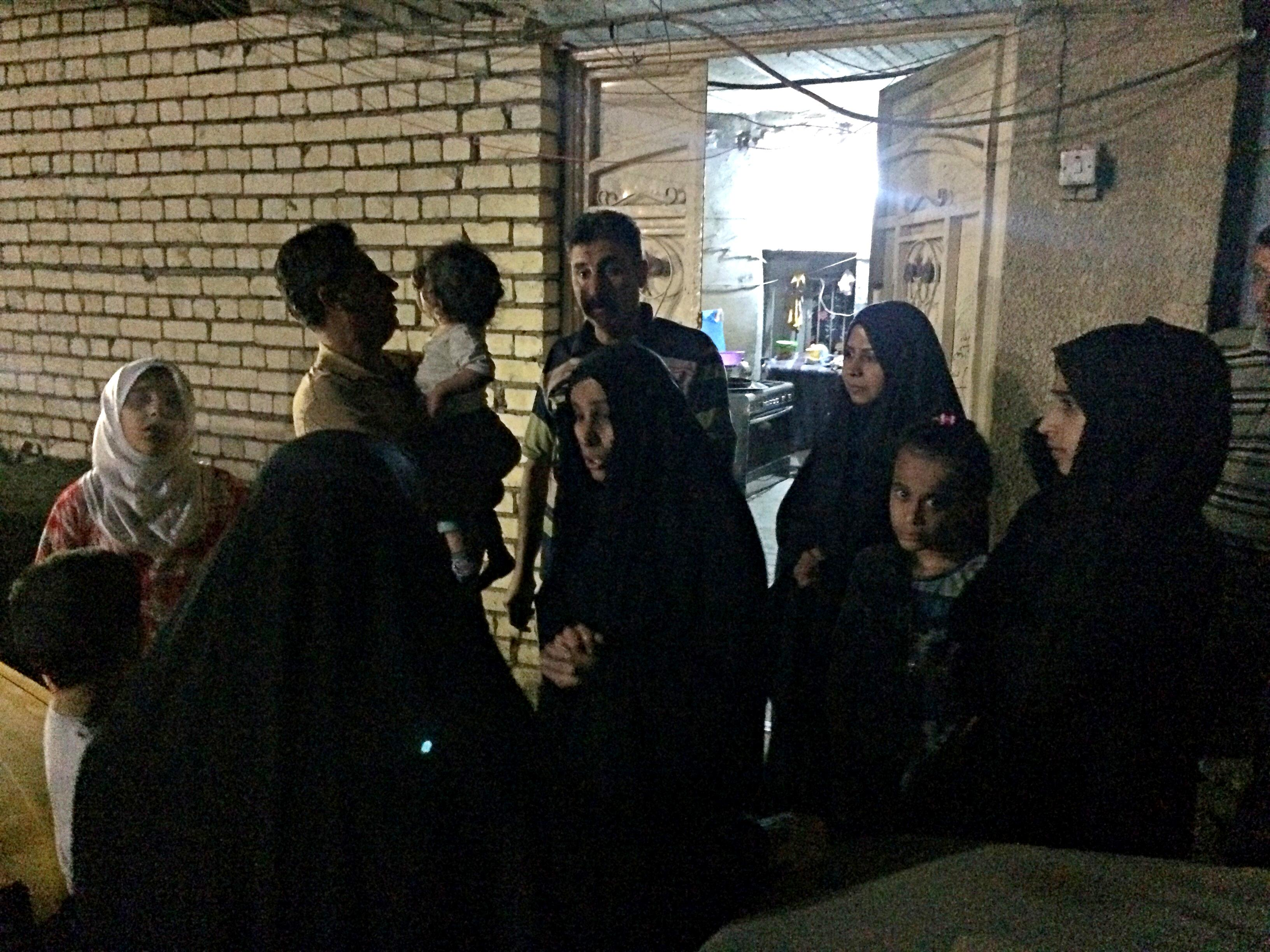 People stand in the street after feeling aftershocks from an earthquake in Baghdad, Iraq, Sunday, Nov. 12, 2017. The deadly earthquake hit the region along the border between Iran and Iraq on Sunday. The U.S. Geological Survey said the quake was centered 19 miles (31 kilometers) outside the eastern Iraqi city of Halabja. (AP Photo/Hadi Mizban)