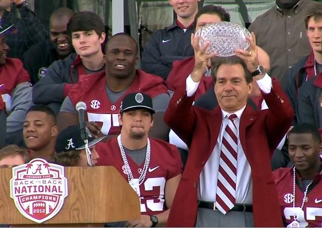 Alabama head coach Nick Saban holds up the BCS National Championship crystal ball during a celebration on Saturday, January 19, 2013.