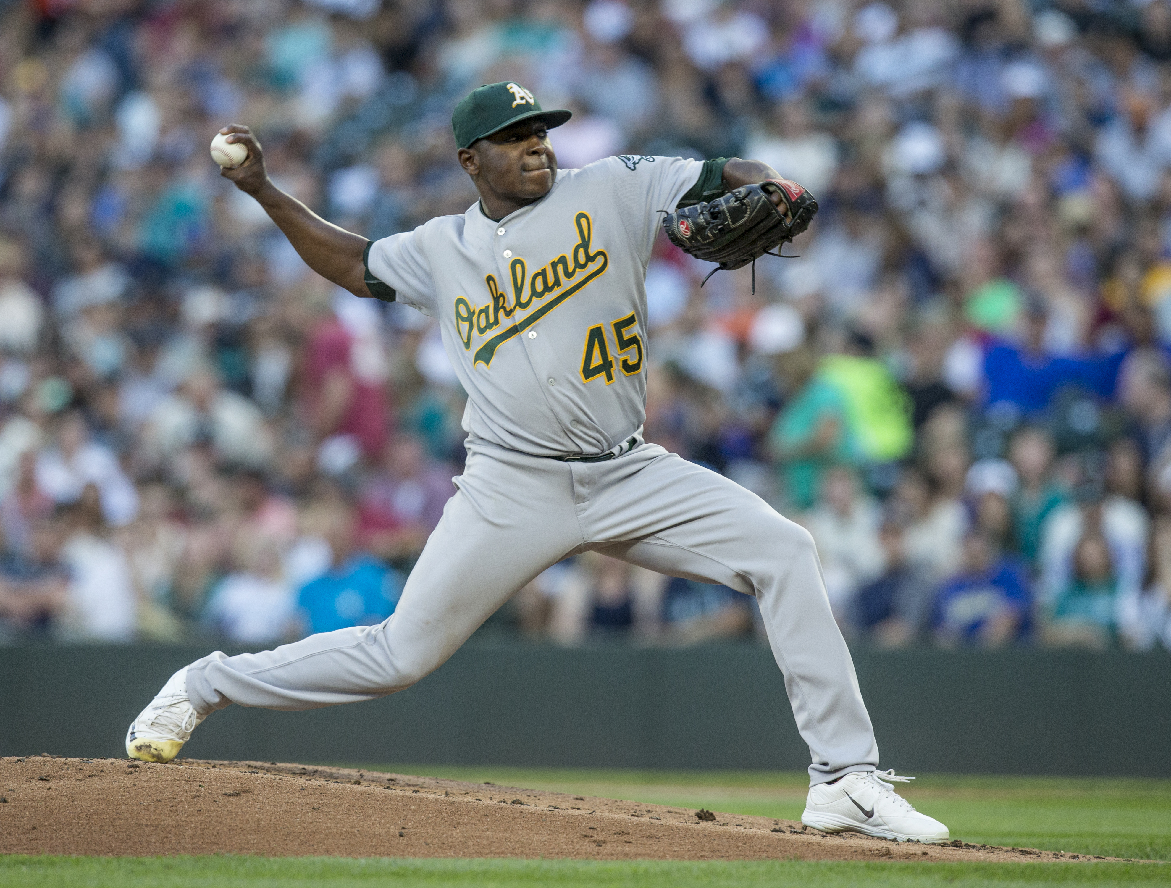 Oakland Athletics starter Jharel Cotton winds up during the first inning of a baseball game against the Seattle Mariners on Saturday, Sept. 2, 2017, in Seattle. (AP Photo/Stephen Brashear)