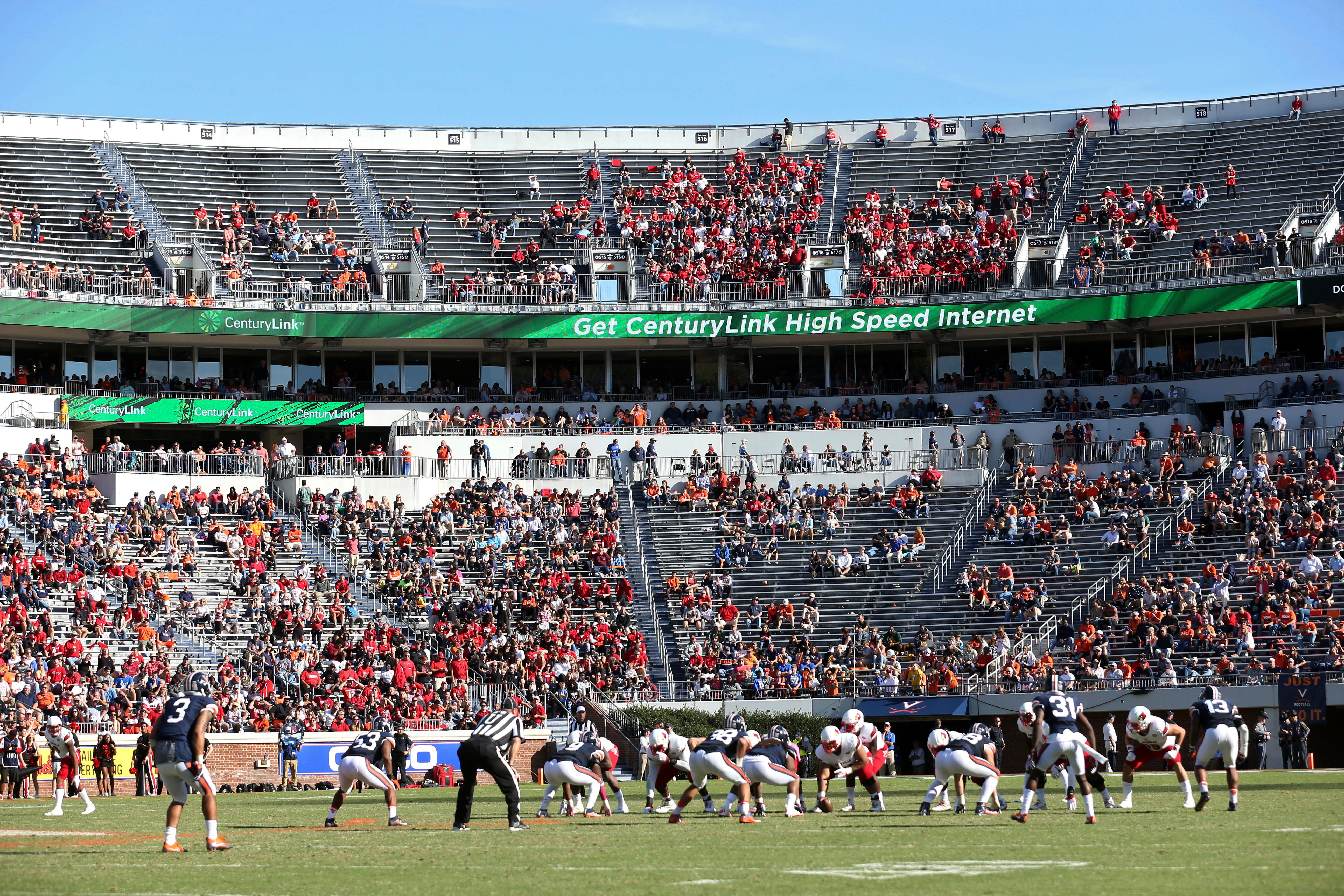 FILE - In this Oct. 29, 2016, file photo, Louisville lines up for a play against Virginia during an NCAA college football game in Charlottesville, Va.  (AP Photo/Ryan M. Kelly, File)