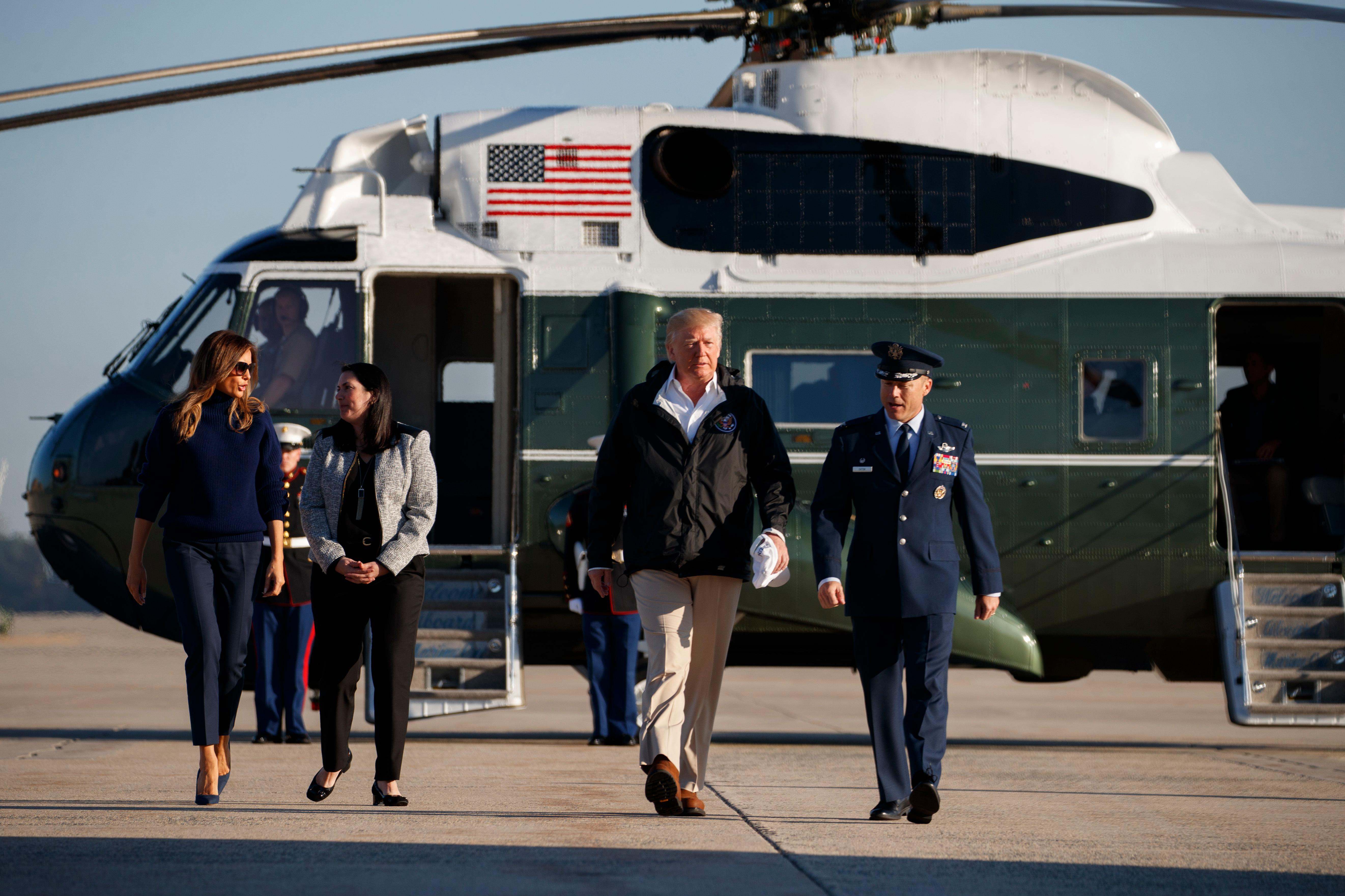President Donald Trump and first lady Melania Trump walk to board Air Force One for a trip to Puerto Rico to survey hurricane damage and recovery efforts, Tuesday, Oct. 3, 2017, in Andrews Air Force Base, Md. (AP Photo/Evan Vucci)