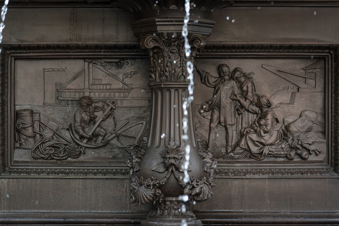 FIRST LEVEL: Four bas reliefs are on the inside of the center pedestal, each representing one of the many benefits of water. The relief on the west side highlights the benefit of navigation. / Image: Phil Armstrong, Cincinnati Refined // Published: 5.31.18