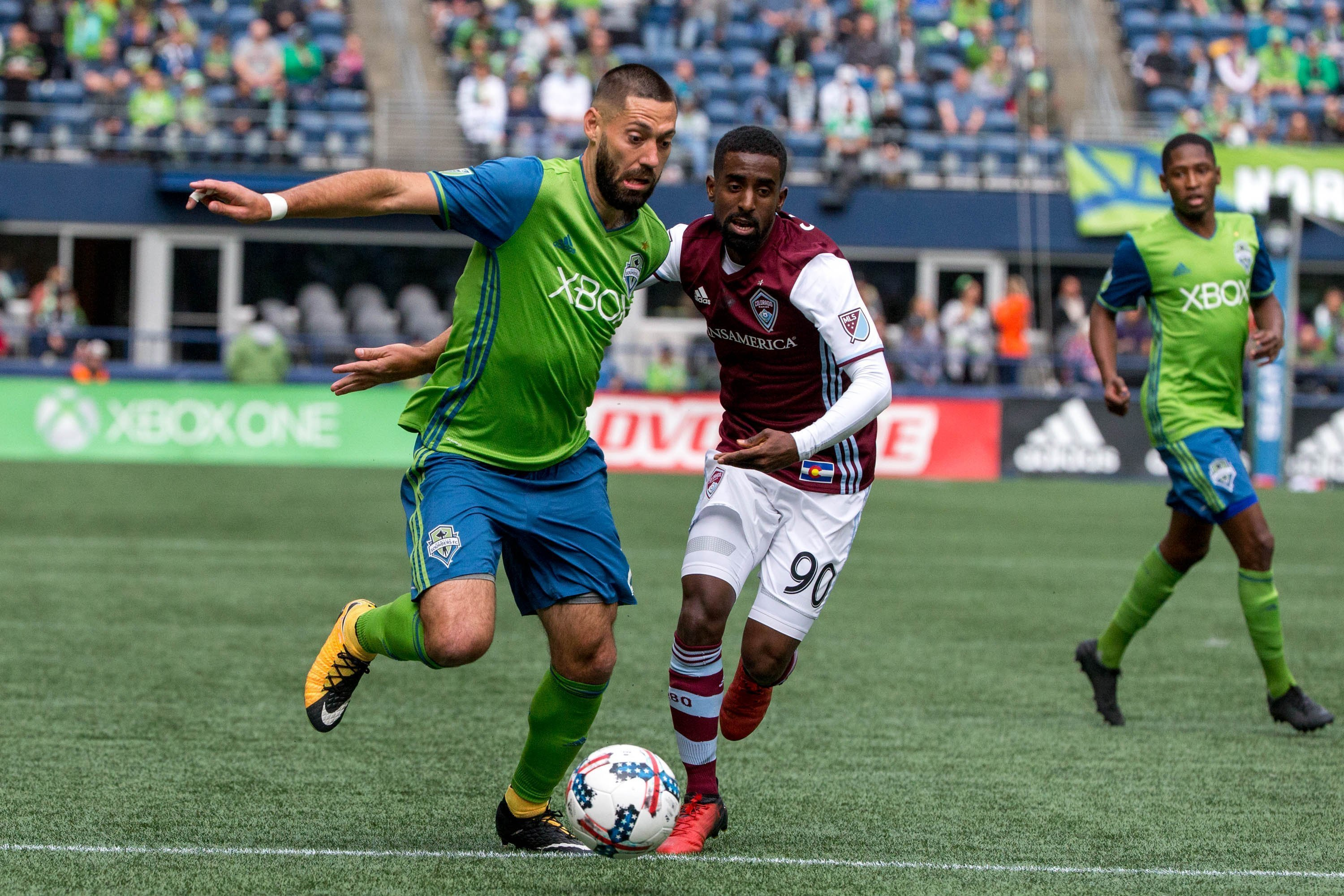Seattle Sounders midfielder Clint Dempsey (2) takes the ball past Colorado Rapids midfielder Mohammed Saeid (90) during the first half of an MLS soccer game in Seattle on Sunday, Oct. 22, 2017. (Courtney Pedroza/The Seattle Times via AP)