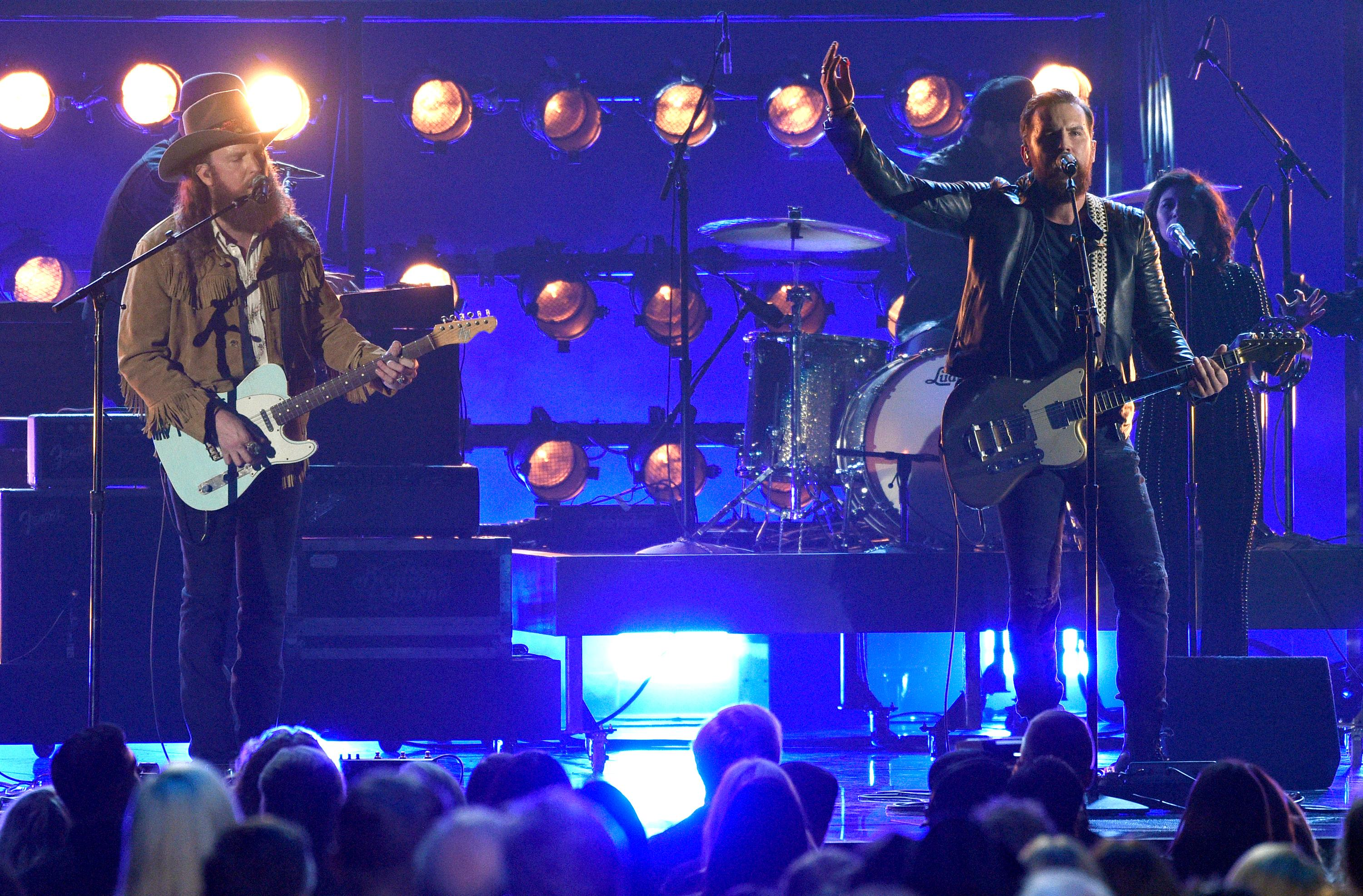 John Osborne, left, and T.J. Osborne, of Brothers Osborne, perform at the 51st annual CMA Awards at the Bridgestone Arena on Wednesday, Nov. 8, 2017, in Nashville, Tenn. (Photo by Chris Pizzello/Invision/AP)