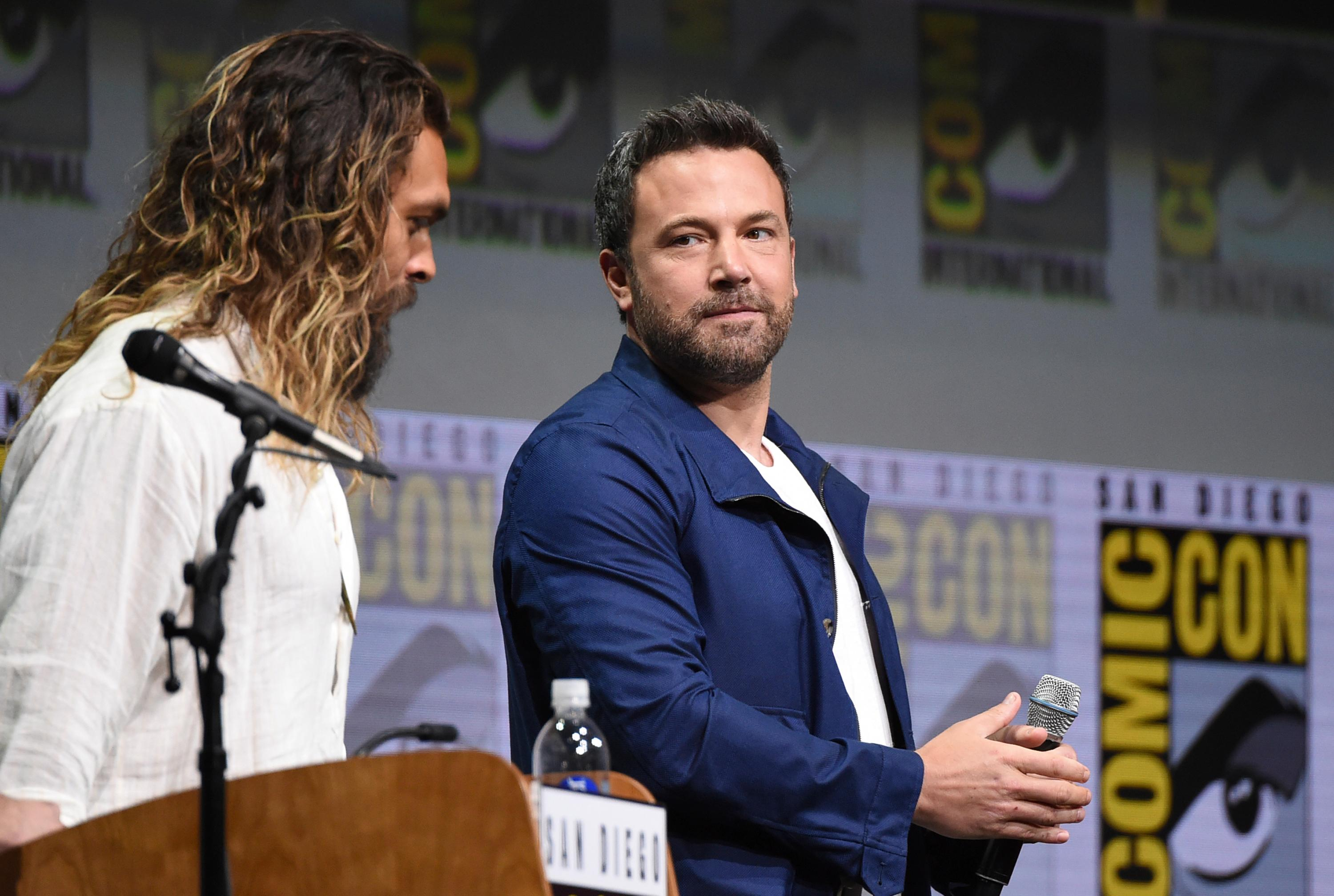"Jason Momoa, left, and Ben Affleck attend the Warner Bros. ""Justice League"" panel on day three of Comic-Con International on Saturday, July 22, 2017, in San Diego. (Photo by Richard Shotwell/Invision/AP)"