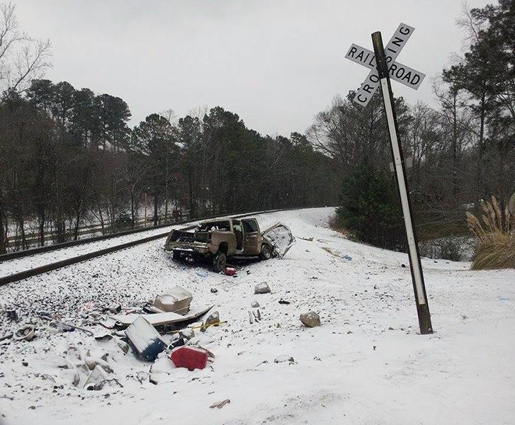 Two people died after a train collided with this truck at a crossing in Tuscaloosa, Tuesday, January 28, 2014.