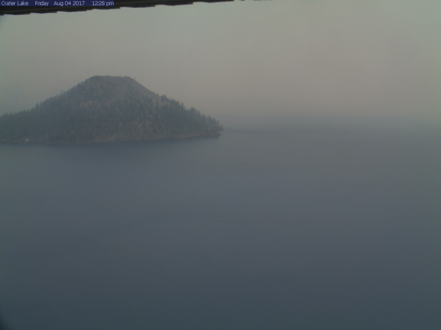 Wizard Island beneath smoky skies on a web camera from Crater Lake National Park on Friday, August 4, 2017.