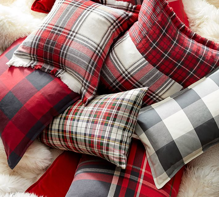 Get Plaid! Plaid is in this year and that means along with your favorite plaid shirt, toss a few plaid accessories around your home. (Image: Pottery Barn)