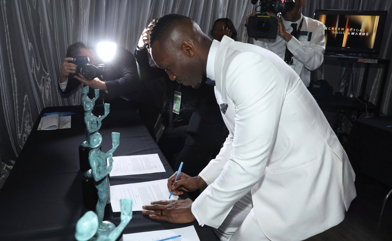 "Mahershala Ali appears backstage as he picks up his awards for outstanding performance by a male actor in a supporting role for ""Moonlight"" and outstanding performance by a cast in a motion picture for ""Hidden Figures"" at the 23rd annual Screen Actors Guild Awards at the Shrine Auditorium & Expo Hall on Sunday, Jan. 29, 2017, in Los Angeles. (Photo by Matt Sayles/Invision/AP)"