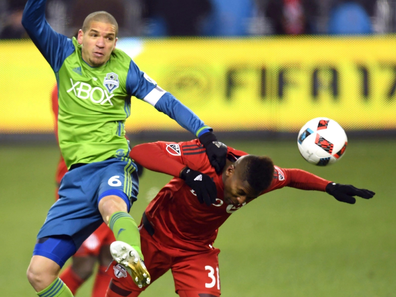 Seattle Sounders midfielder Osvaldo Alonso (6) and Toronto FC midfielder Armando Cooper (31) battle for the ball during first-half MLS Cup final soccer action in Toronto, Saturday, Dec. 10, 2016. (Frank Gunn/The Canadian Press via AP)
