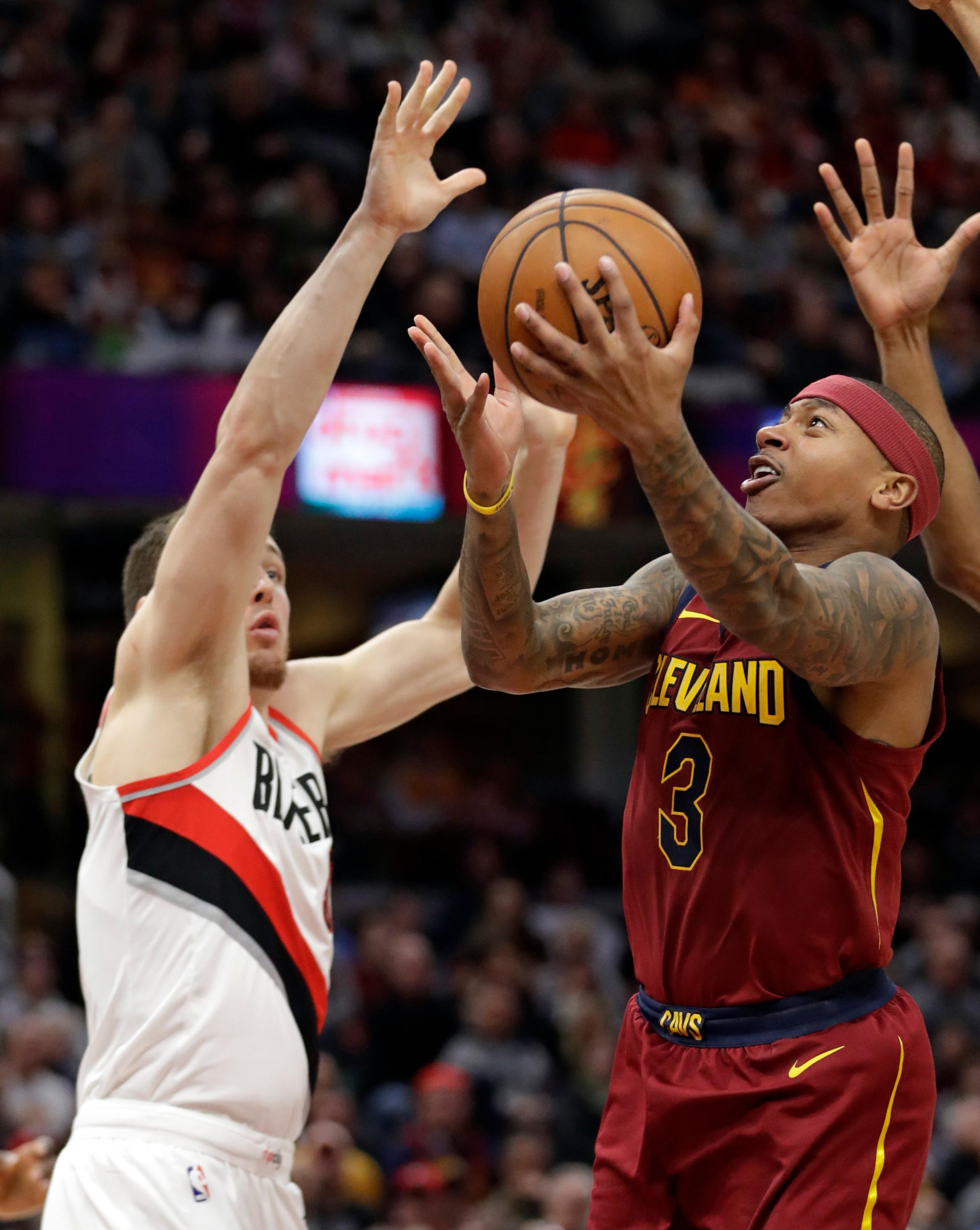 Cleveland Cavaliers' Isaiah Thomas (3) drives to the basket against Portland Trail Blazers' Pat Connaughton (5) in the second half of an NBA basketball game, Tuesday, Jan. 2, 2018, in Cleveland. The Cavaliers won 127-110. (AP Photo/Tony Dejak)