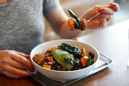 Feed Co.'s Boosted Bowl; chocked full of kale, avocado, roasted yam, lentils, pecans, sunflower seeds, chickpea croquettes, beets, and tied together with a lemon-tahini sauce. (Image: Justin Oba)
