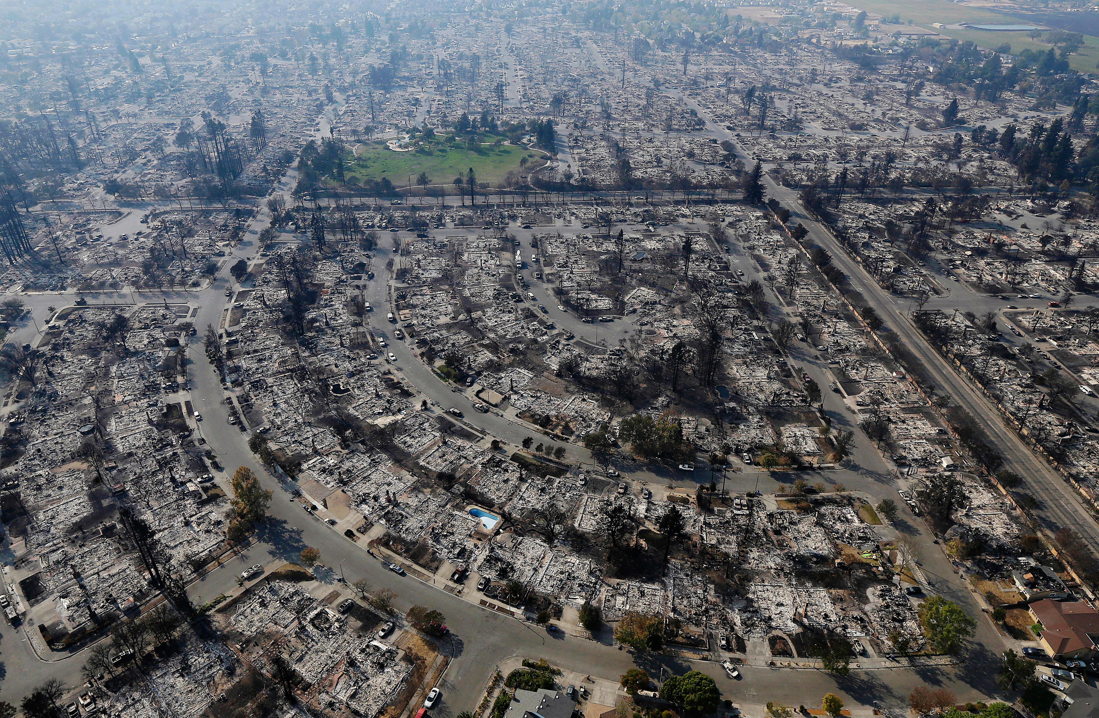 FILE - In this Oct. 11, 2017, file photo, homes burned by a wildfire are viewed in Santa Rosa, Calif. The long and brutal 2017 wildfire season is stressing the state and federal agencies that have to pay for the army of ground crews and machinery required to fight them. (AP Photo/Jeff Chiu, File)