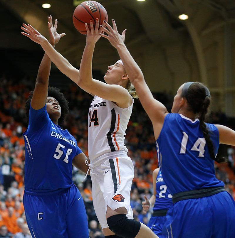 Oregon State's Sydney Wiese (24) gets between Creighton's Brianna Rollerson (50) and Sydney Lamberty during the second half of a second-round game in the NCAA women's college basketball tournament Sunday, March 19, 2017, in Corvallis, Ore. Oregon State won 64-52. (AP Photo/Timothy J. Gonzalez)