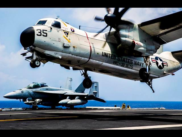 A U.S. Navy C-2A Greyhound aircraft prepares to land aboard the aircraft carrier the USS George Washington in the Pacific Ocean, June 4, 2014.