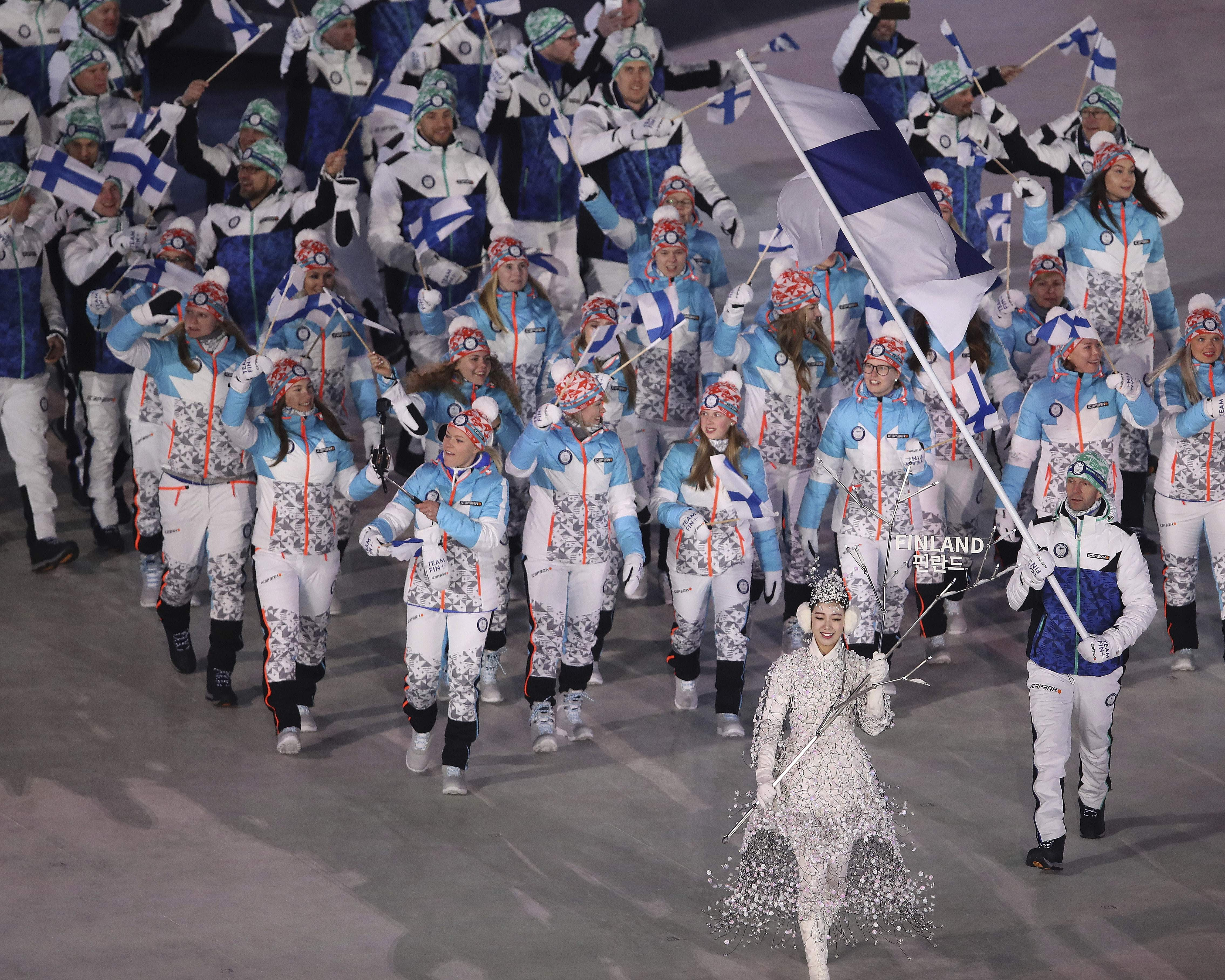 Janne Ahonen carries the flag of Finland during the opening ceremony of the 2018 Winter Olympics in Pyeongchang, South Korea, Friday, Feb. 9, 2018. (Sean Haffey/Pool Photo via AP)
