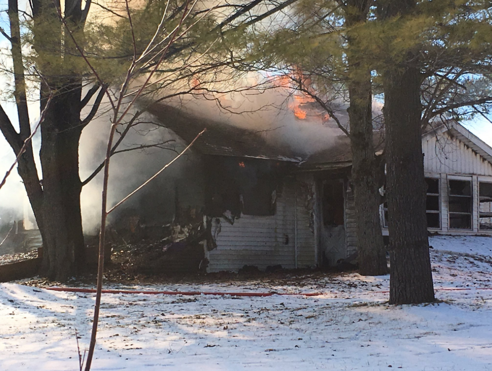 Police are advising people to avoid the area of West Kitchen road between 11 Mile and Garfield Roads in Linwood because of a house fire. (Photo Credit:  Miranda Parnell)