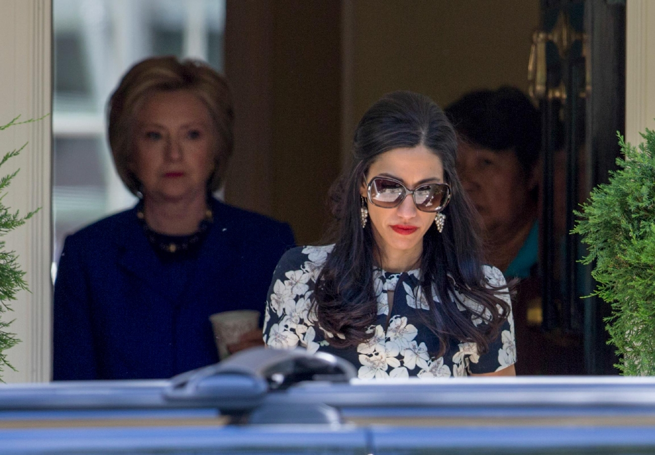 Top Clinton aide Huma Abedin walks ahead of Democratic presidential candidate Hillary Clinton following a private meeting with Sen. Elizabeth Warren, D-Mass., Friday, June 10, 2016, at Clinton's home in Washington. The FBI has obtained a warrant to begin reviewing newly discovered emails that may be relevant to the Hillary Clinton email server investigation, a law enforcement official told The Associated Press. FBI investigators want to review emails of longtime Clinton aide Huma Abedin that were found on a device seized during an unrelated sexting investigation of Anthony Weiner, a former New York congressman and Abedin's estranged husband. (AP Photo/J. Scott Applewhite)