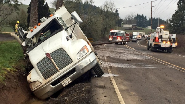 Truck knocks down power pole on Hwy. 47, pole hits SUV