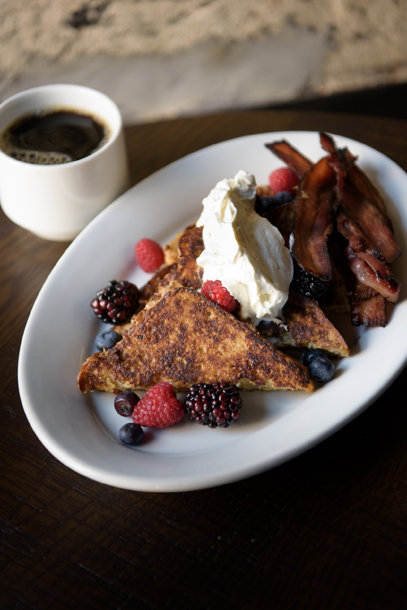 You cannot go wrong with the Challah French toast coronated with seasonal berries, Chantilly cream and pork belly bacon accented with hickory smoke and maple sugar.(Image: Jeff Martin)