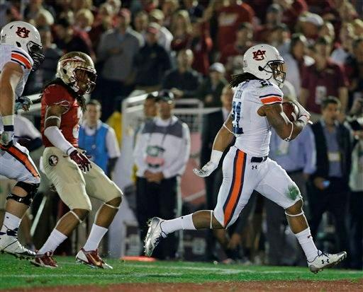 Auburn's Tre Mason breaks away for a touchdown run during the first half of the NCAA BCS National Championship college football game against Florida State Monday, Jan. 6, 2014, in Pasadena, Calif.
