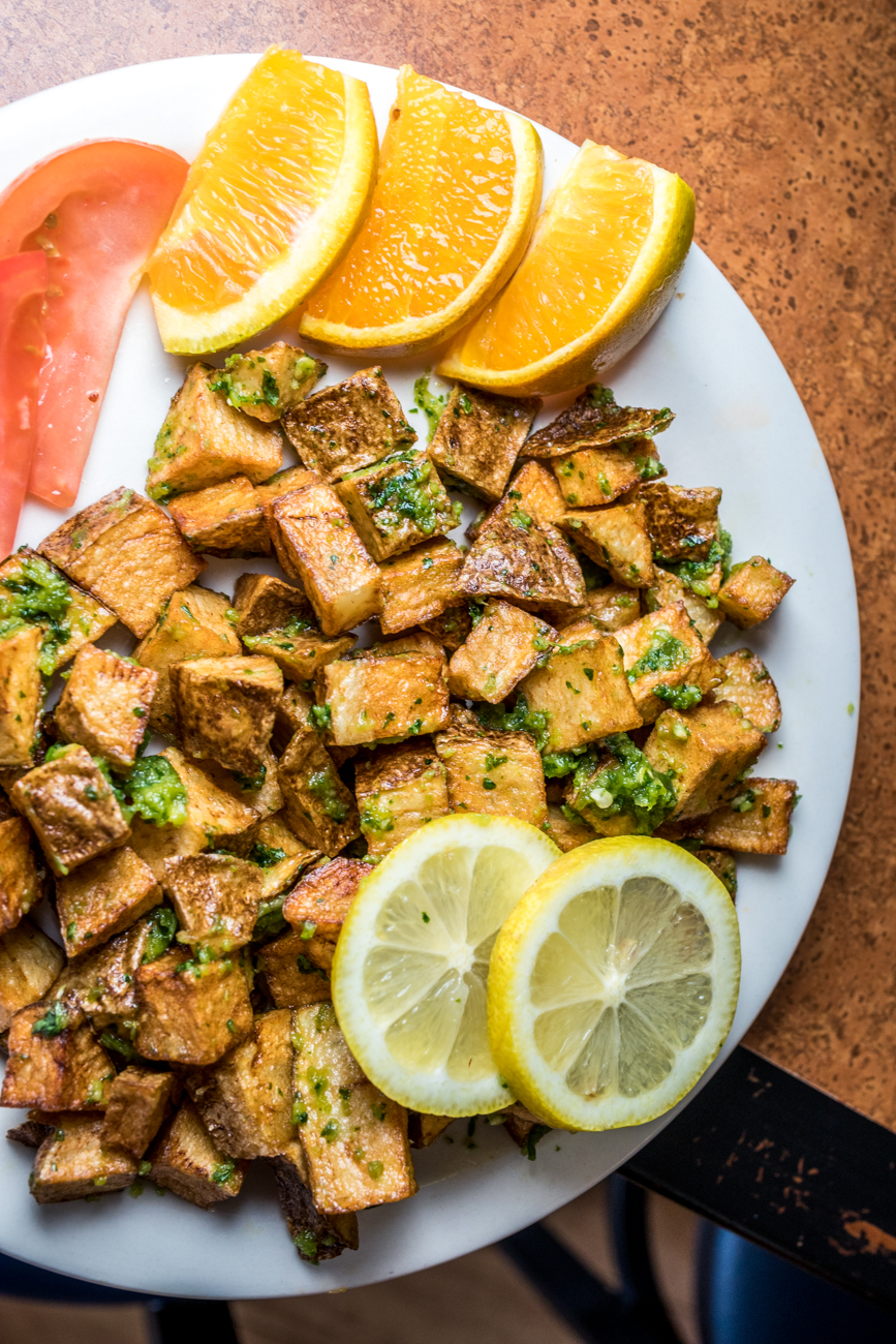 Spicy Potatoes (Batata Harrah): fried cubed potatoes mixed with chopped cilantro, garlic, and salt / Image: Catherine Viox{ }// Published: 9.23.20