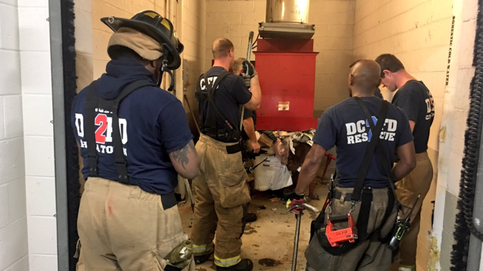 Garbage Chute Fire : Officials firefighters rescue man who fell down trash