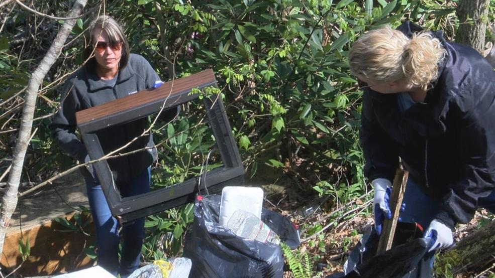 Volunteers work to clean up Carter County illegal dump site
