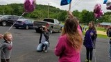 Family and friends celebrate Kassidy Dains' birthday with a balloon release