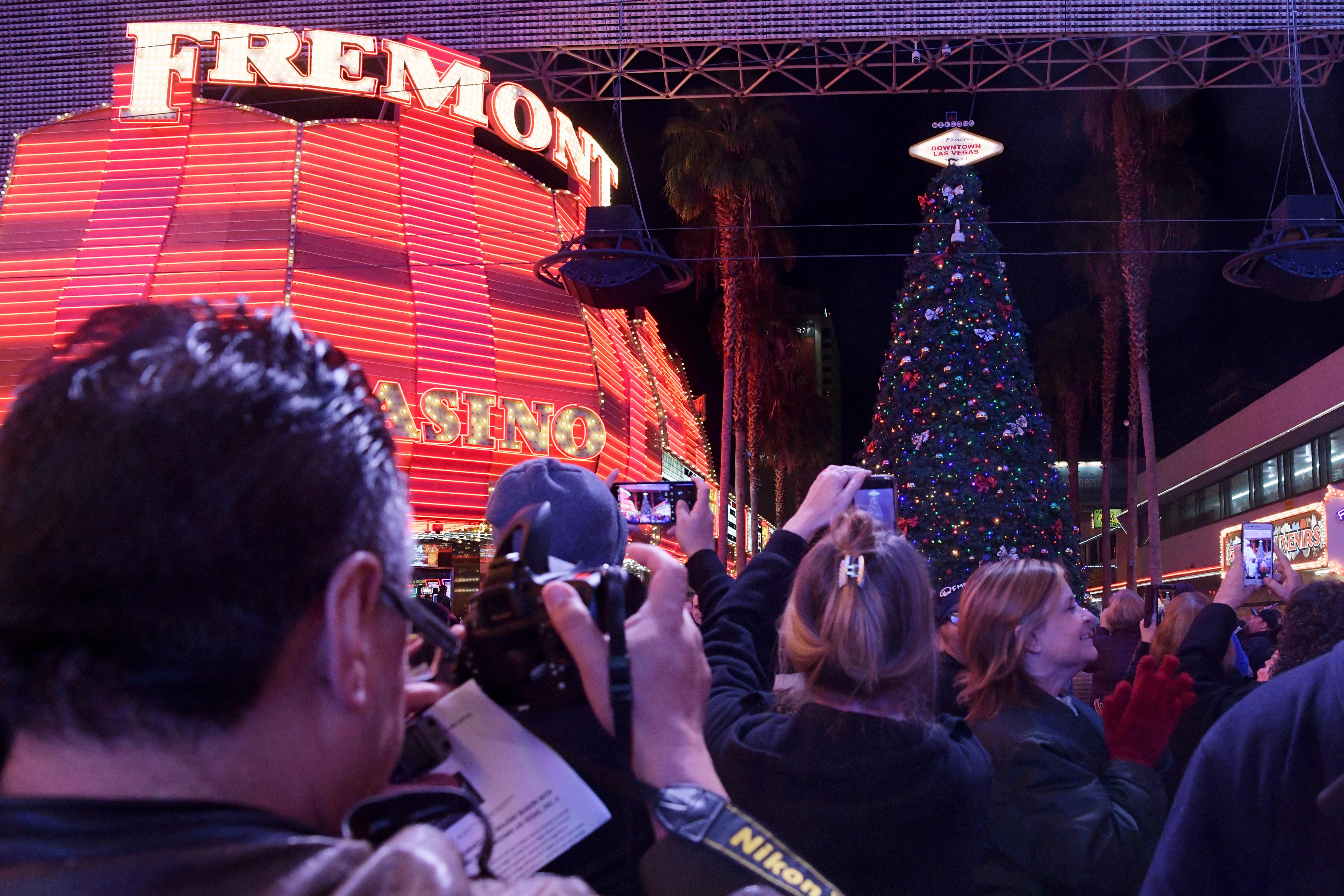 People turn to look at the lit tree during the annual lighting of a Christmas tree at the Fremont Street Experience Tuesday, December 4, 2018. CREDIT: Sam Morris/Las Vegas News Bureau
