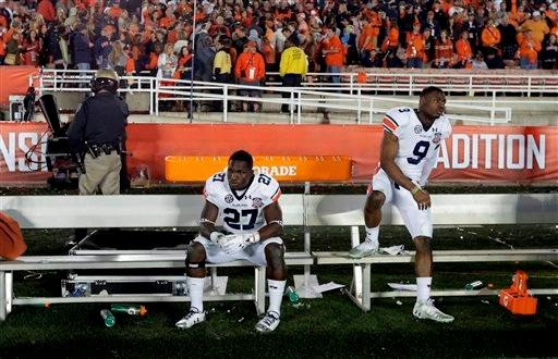 Auburn's Robenson Therezie (27) and Jermaine Whitehead (9) react following the NCAA BCS National Championship college football game against Florida State Monday, Jan. 6, 2014, in Pasadena, Calif. Florida State won 34-31.