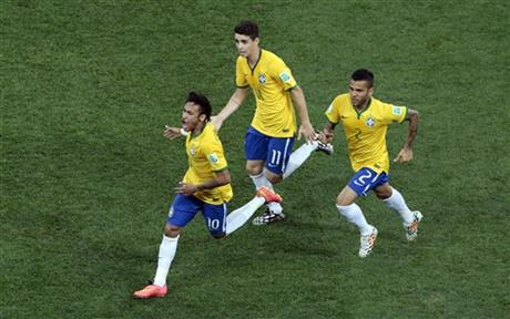 Brazil's Neymar, left, celebrates scoring his side's first goal during the group A World Cup soccer match between Brazil and Croatia, the opening game of the tournament, in the Itaquerao Stadium in Sao Paulo, Brazil, Thursday, June 12, 2014.