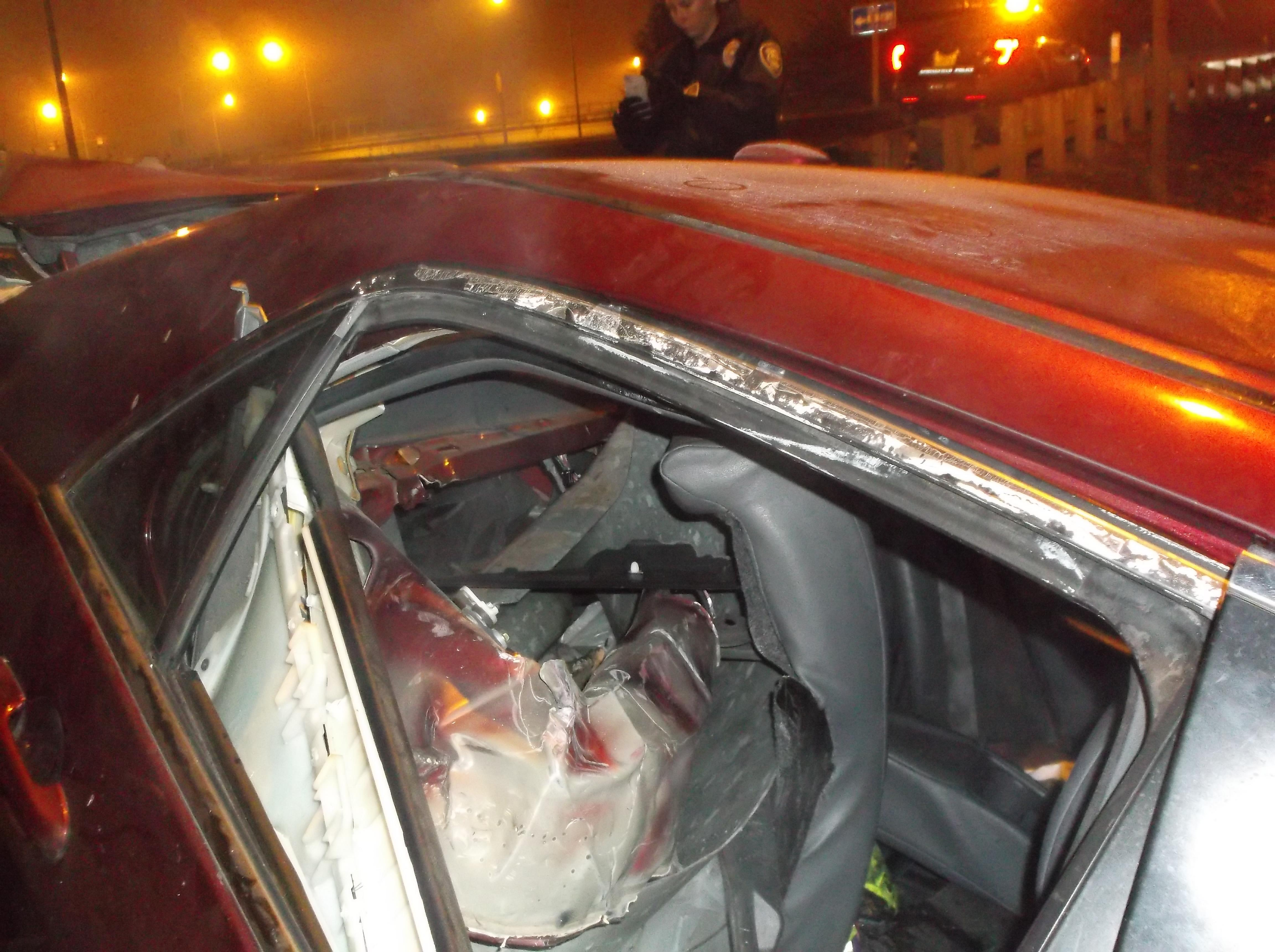 <p>Police say the collision caused the Honda to spin backwards into the steel shoulder barrier, which collapsed the entire rear-end of the car, puncturing through the rear seat at an angle and forcing the rear passenger-side door open. (Springfield Police Department photo)</p>