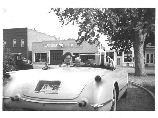 A family photo shows Mildred Lambrecht, wife of the dealership owner, and their son Mark in a new 1953 Corvette -- the very first year of Corvette -- in front of the store. Ray Lambrecht, now 95, retired in 1996.