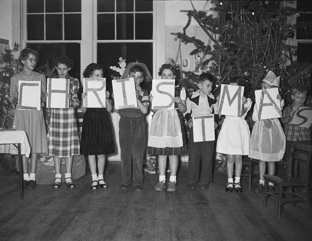 The 1950 Christmas pageant in the one-room Robinette school. Left to right: Charlene Whitely, Joan Robinette, Diane Carrithers, Richard Carrithers, Linda Buchanan, Earl Robinette, Betty Basche, Karen Whitely, Petey Basche. (Pete Basche/Baker County Historic Photo Collection)