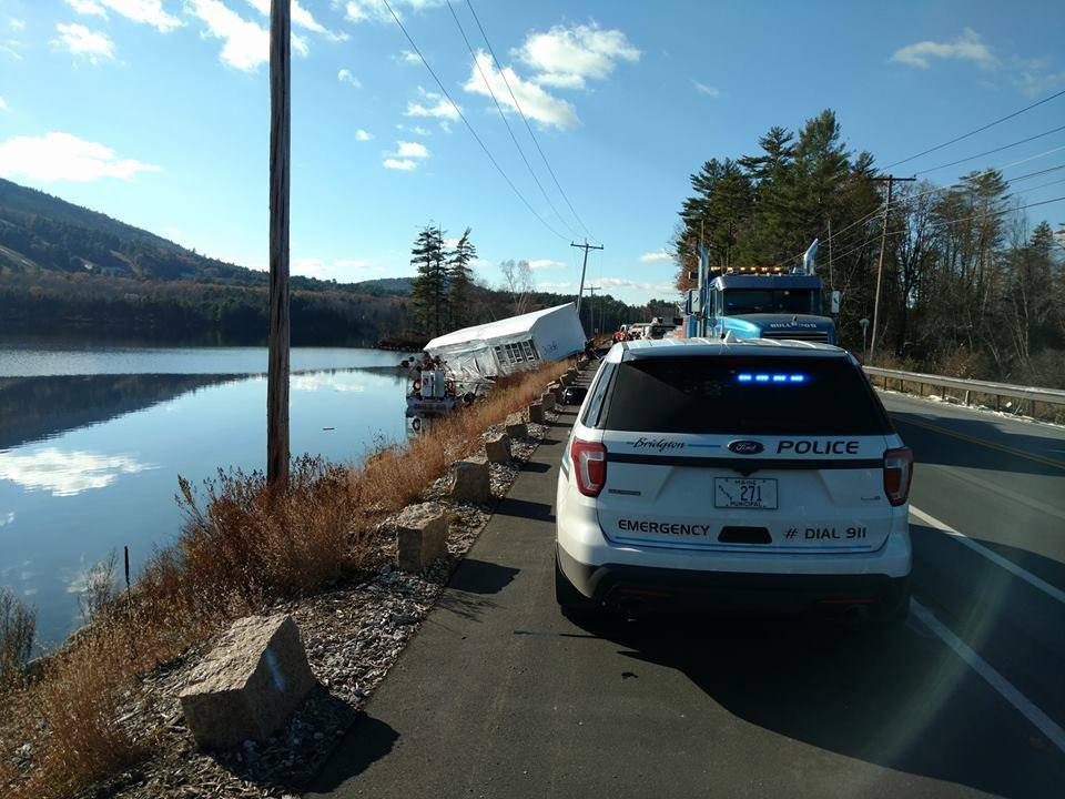 Police say a tractor-trailer that was hauling a modular home has plunged into Moose Pond in Bridgton. (Courtesy: Peter Morrison)