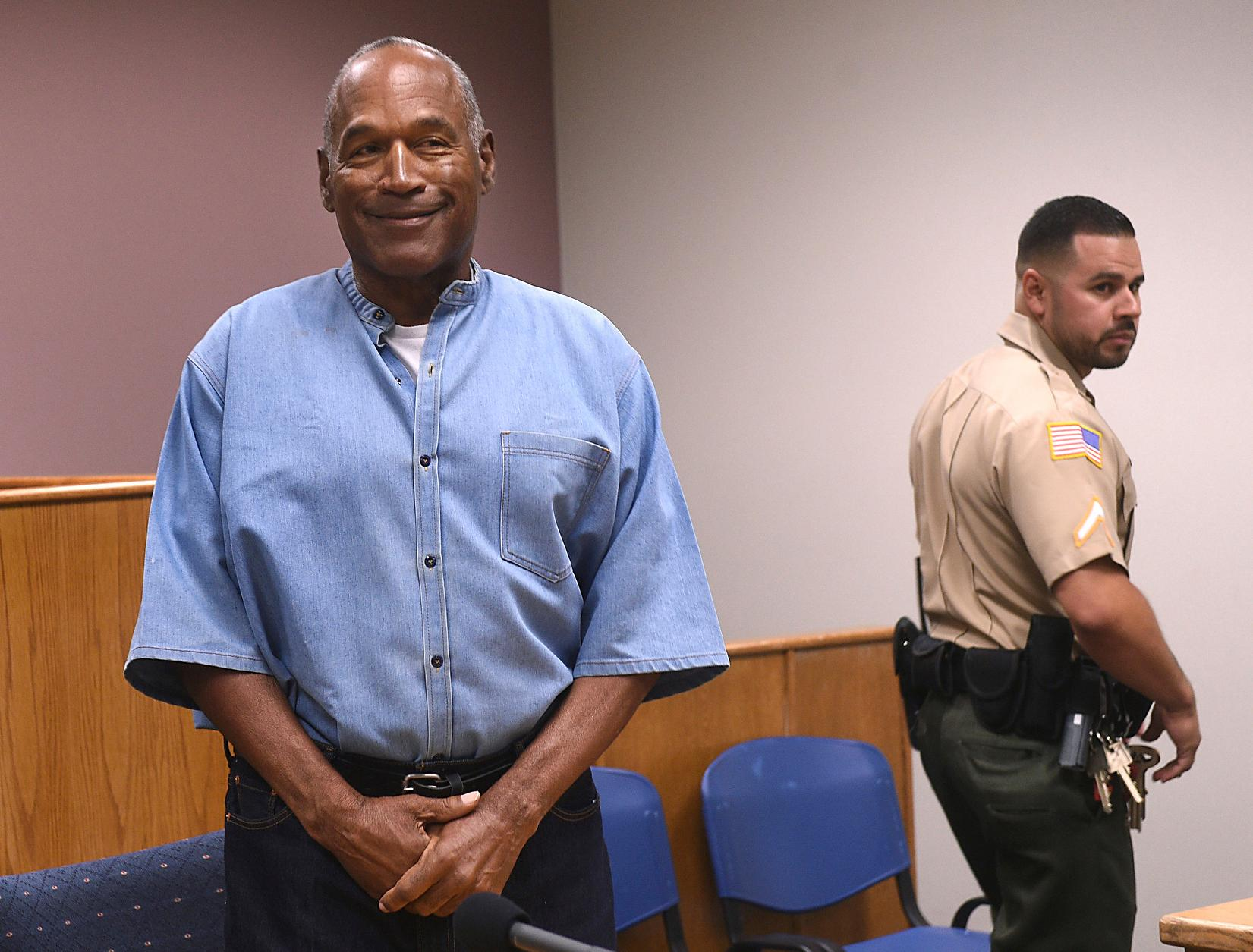 FILE - In this July 20, 2017, file photo, former NFL football star O.J. Simpson enters for his parole hearing at the Lovelock Correctional Center in Lovelock, Nev. Simpson enjoys living in Las Vegas, and isn't planning to move to Florida like he told state parole officials before he was released in October from Nevada state prison. (Jason Bean/The Reno Gazette-Journal via AP, Pool, File)