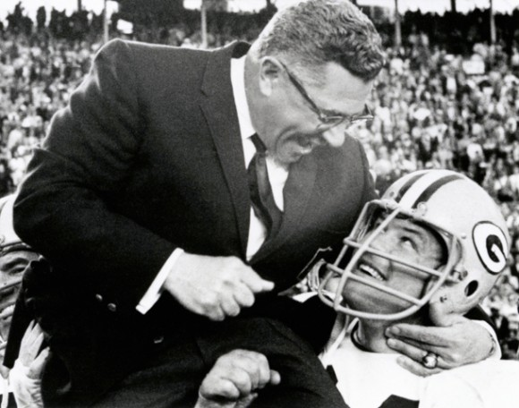 Green Bay Packers Hall of Fame coach Vince Lombardi is carried off the field by guard Jerry Kramer after their Super Bowl victory against the Oakland Raiders in Miami, Fla., Jan. 14, 1968. (AP Photo/NFL Photos/Vernon Biever)
