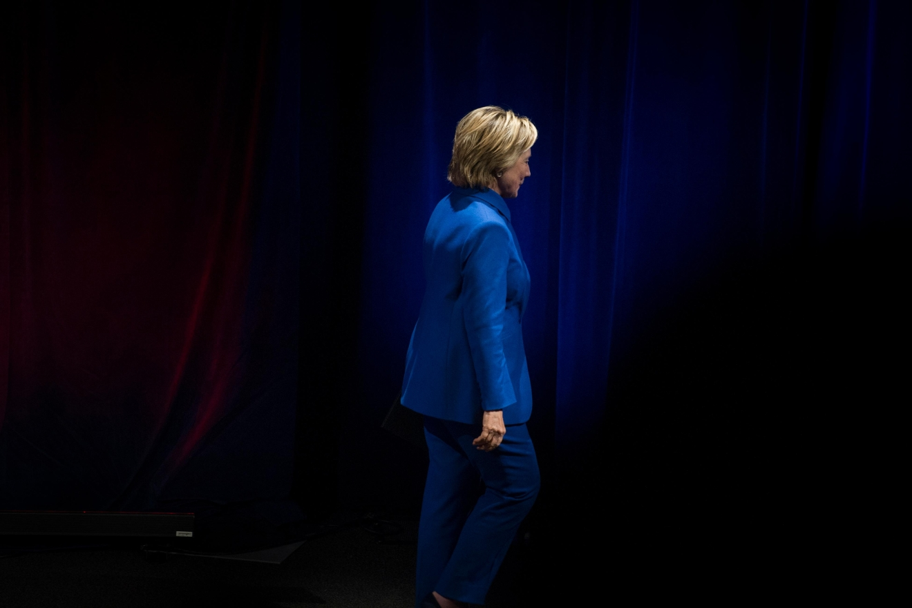 Hillary Clinton walks offstage after addressing the Children's Defense Fund's Beat the Odds celebration at the Newseum in Washington, Wednesday, Nov. 16, 2016. (AP Photo/Cliff Owen)