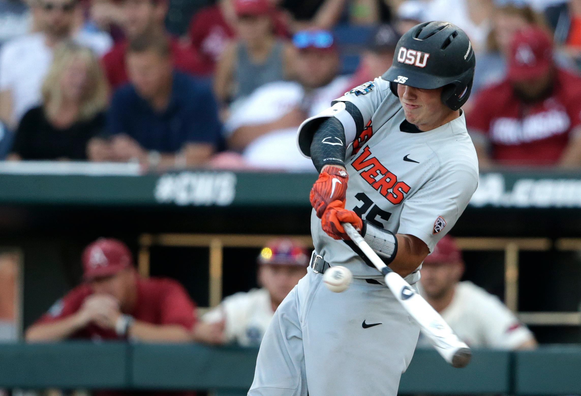 Oregon State's Adley Rutschman singles against Arkansas during the fifth inning of Game 3 of the NCAA College World Series baseball finals, Thursday, June 28, 2018, in Omaha, Neb. (AP Photo/Nati Harnik)