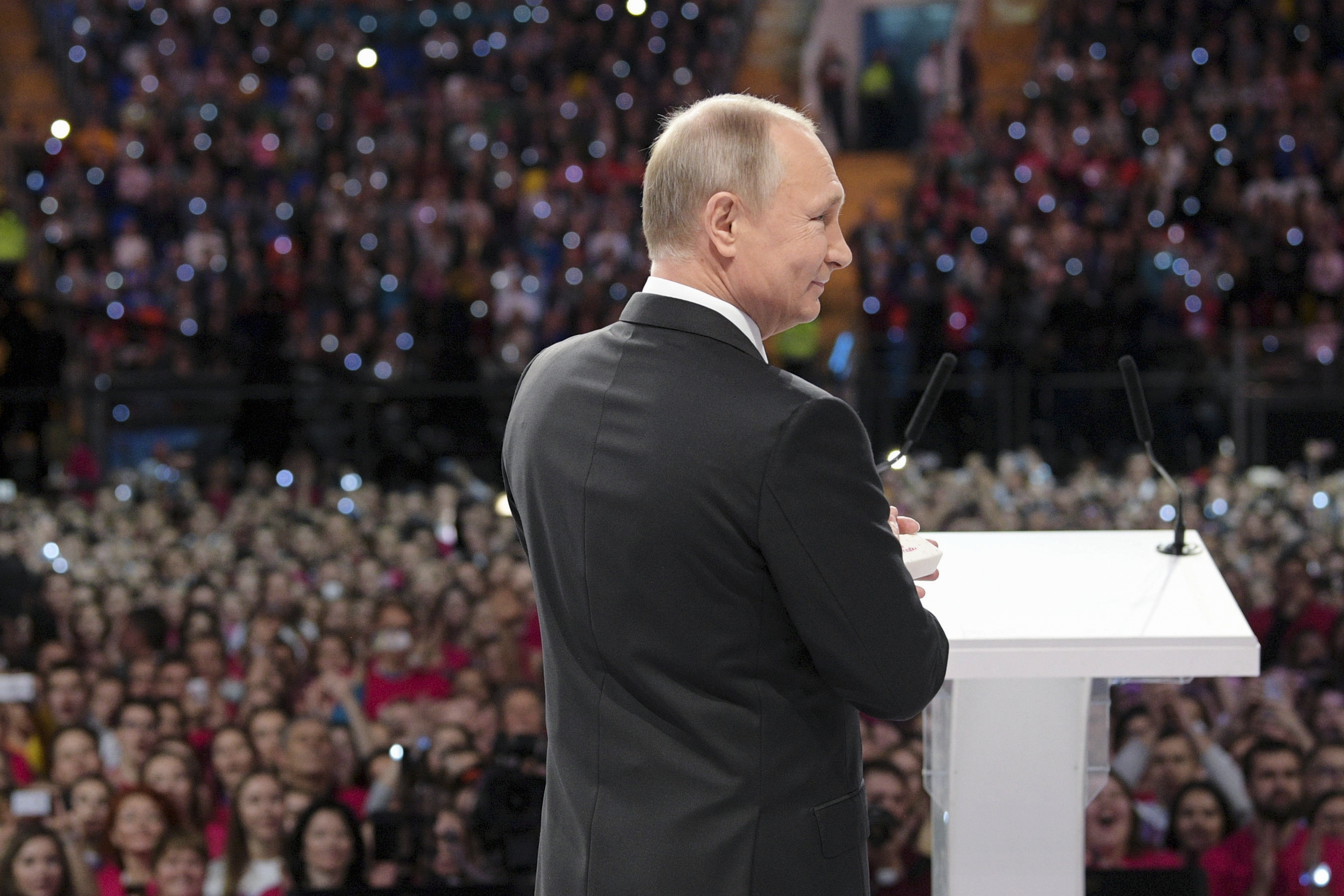 Russian President Vladimir Putin attends the annual Volunteer of Russia 2017 award ceremony at the Megasport Sport Palace in Moscow, Russia, Wednesday, Dec. 6, 2017. Putin has moved an inch closer to announcing his intention to seek re-election in the next March's vote, saying he would weigh the move based on public support.(Alexei Druzhinin, Sputnik, Kremlin Pool Photo via AP)