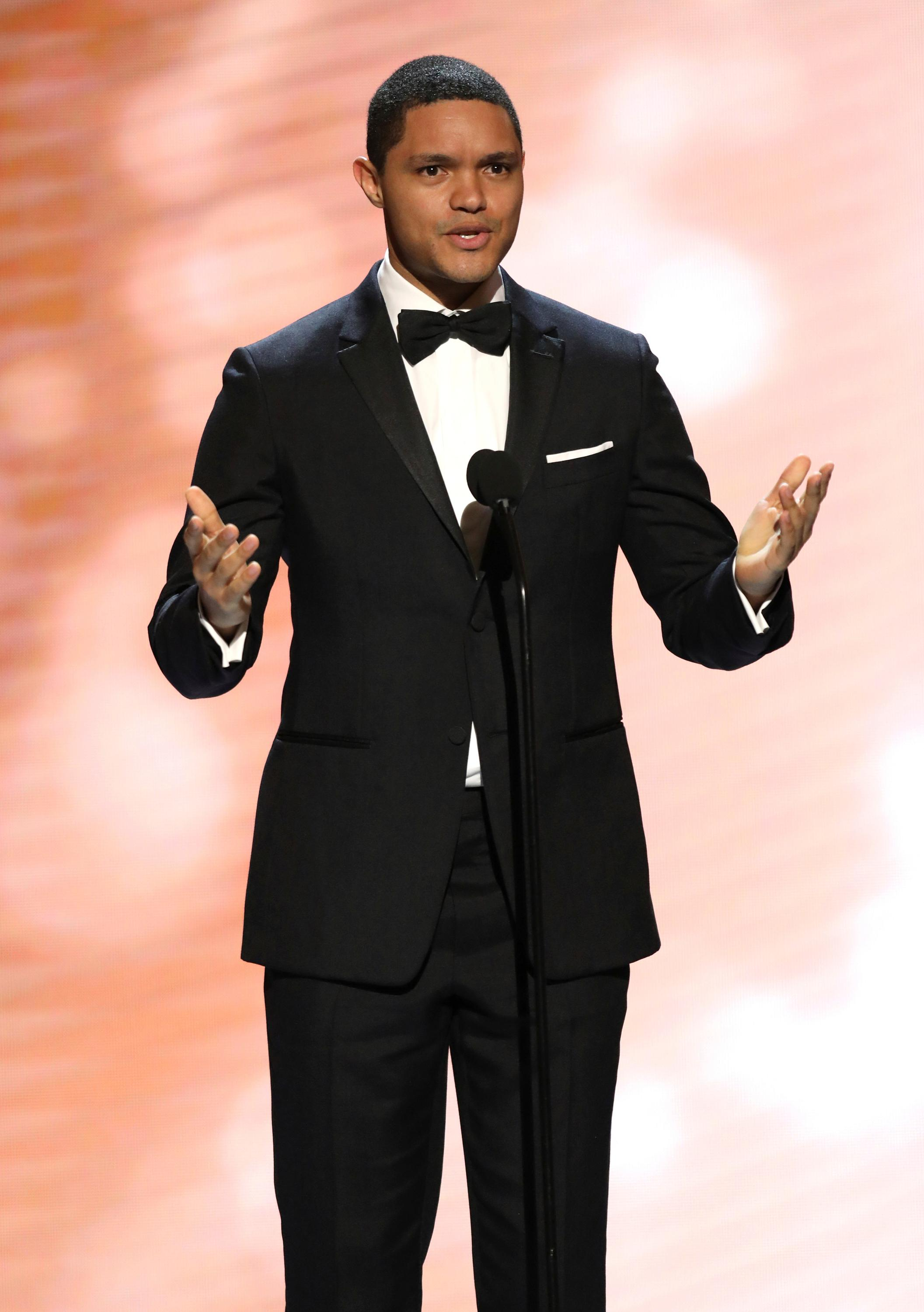 FILE - In this Feb. 11, 2017, file photo, Trevor Noah presents the award for outstanding actress in a comedy series at the 48th annual NAACP Image Awards at the Pasadena Civic Auditorium in Pasadena, Calif. Late-night comics decried the Las Vegas mass shooting as a confoundingly repetitive American tragedy, with Jimmy Kimmel and Noah lashing out at politicians who oppose gun control. They spoke out on Monday, Oct. 2, the day after the worst shooting in modern U.S. history. (Photo by Matt Sayles/Invision/AP, File)