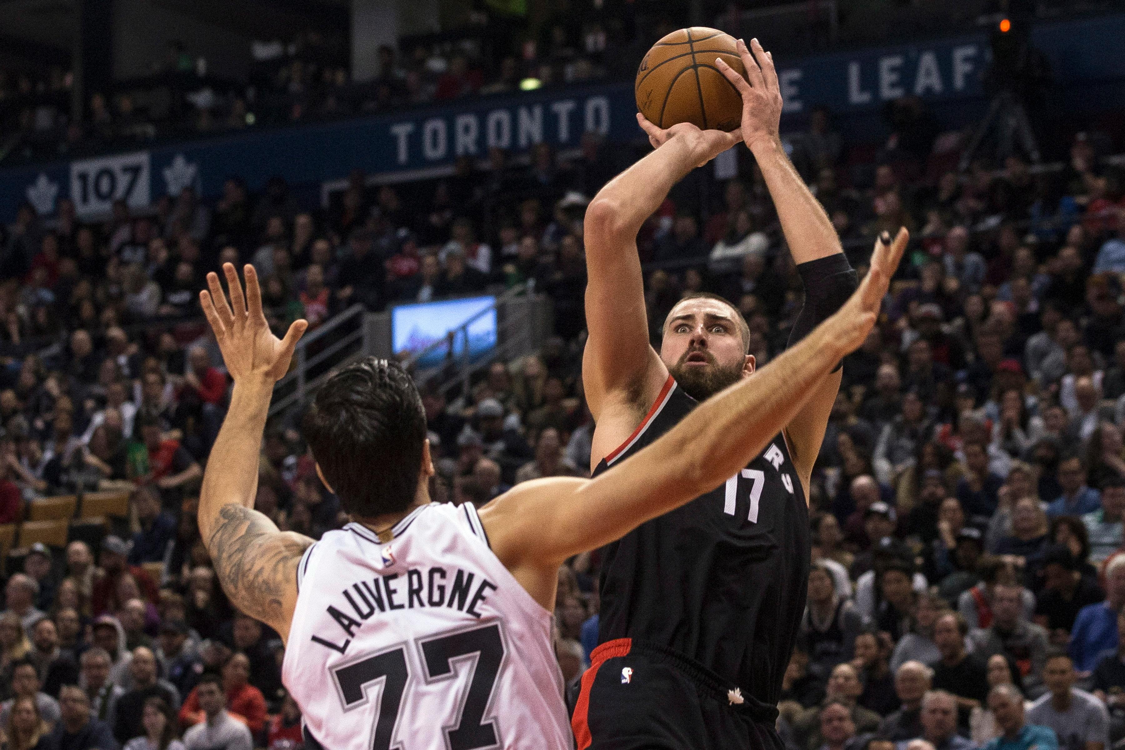 Toronto Raptors center Jonas Valanciunas (17) shoots over San Antonio Spurs center Joffrey Lauvergne (77) during the second half of an NBA basketball game Friday, Jan. 19, 2018, in Toronto. (Chris Young/The Canadian Press via AP)