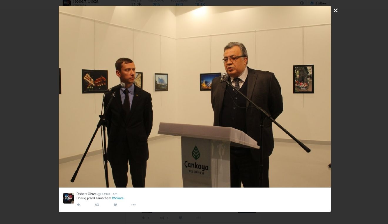 A photo of Adrei Karlov, a Russian ambassador, moments before he was wounded by gunfire in Turkey while visiting an art gallery in Ankara Monday, December 19, 2016. (Photo courtesy Robert Olsza Twitter @ROIsza)