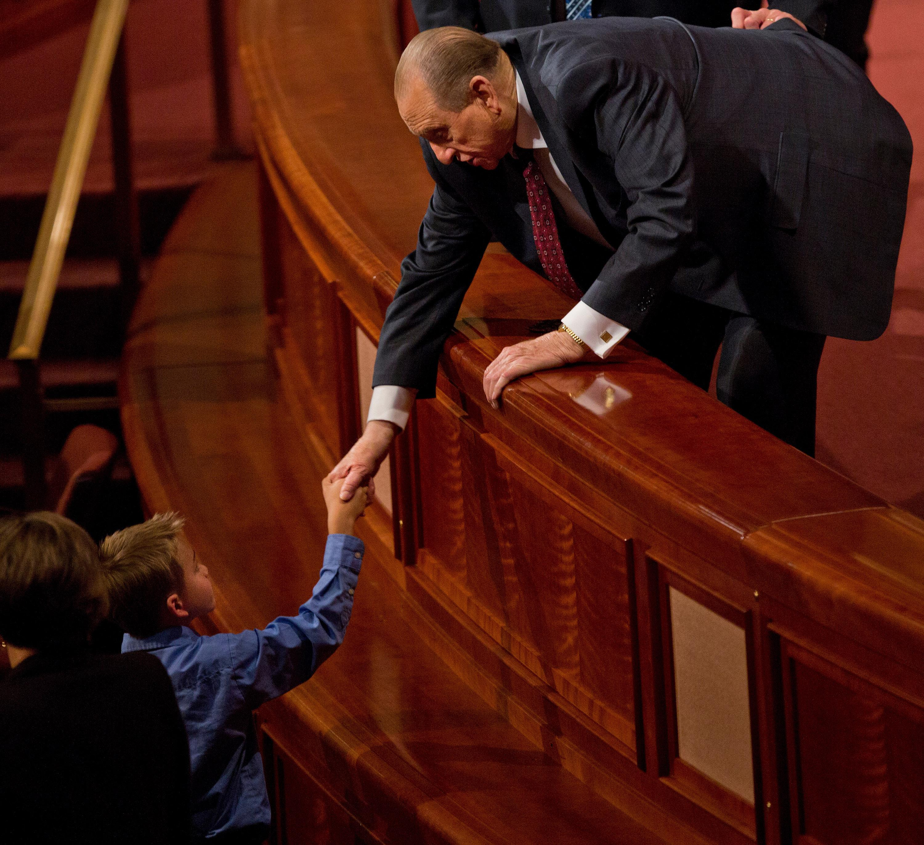President Thomas S. Monson shakes hands with a boy at the Saturday afternoon session of general conference, October 5, 2013. (Photo: MormonNewsroom.org)<p></p>