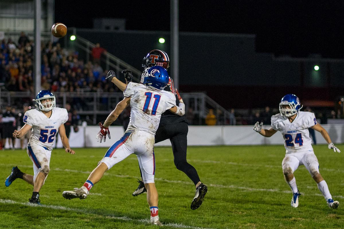 Churchill's Lucas Schwin (#11) competes with a Thurston Colt for a reception. The Churchill Lancers defeated the Thurston Colts 40 - 35 at Thurston High School on Friday, September 29.