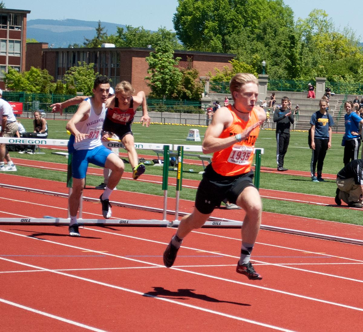 Brock Rogers of Silverton wins first place in the Boy's 5A 110m High Hurdle with a time of 14.89 at Hayward Field. Photo by Sheridan Kowta, Oregon News Lab