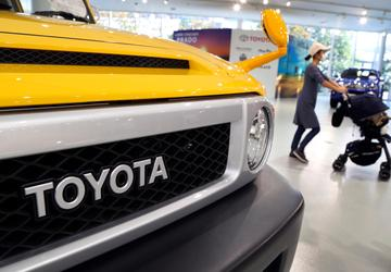 Toyota lifts profit forecast to record 2.4 trillion yen