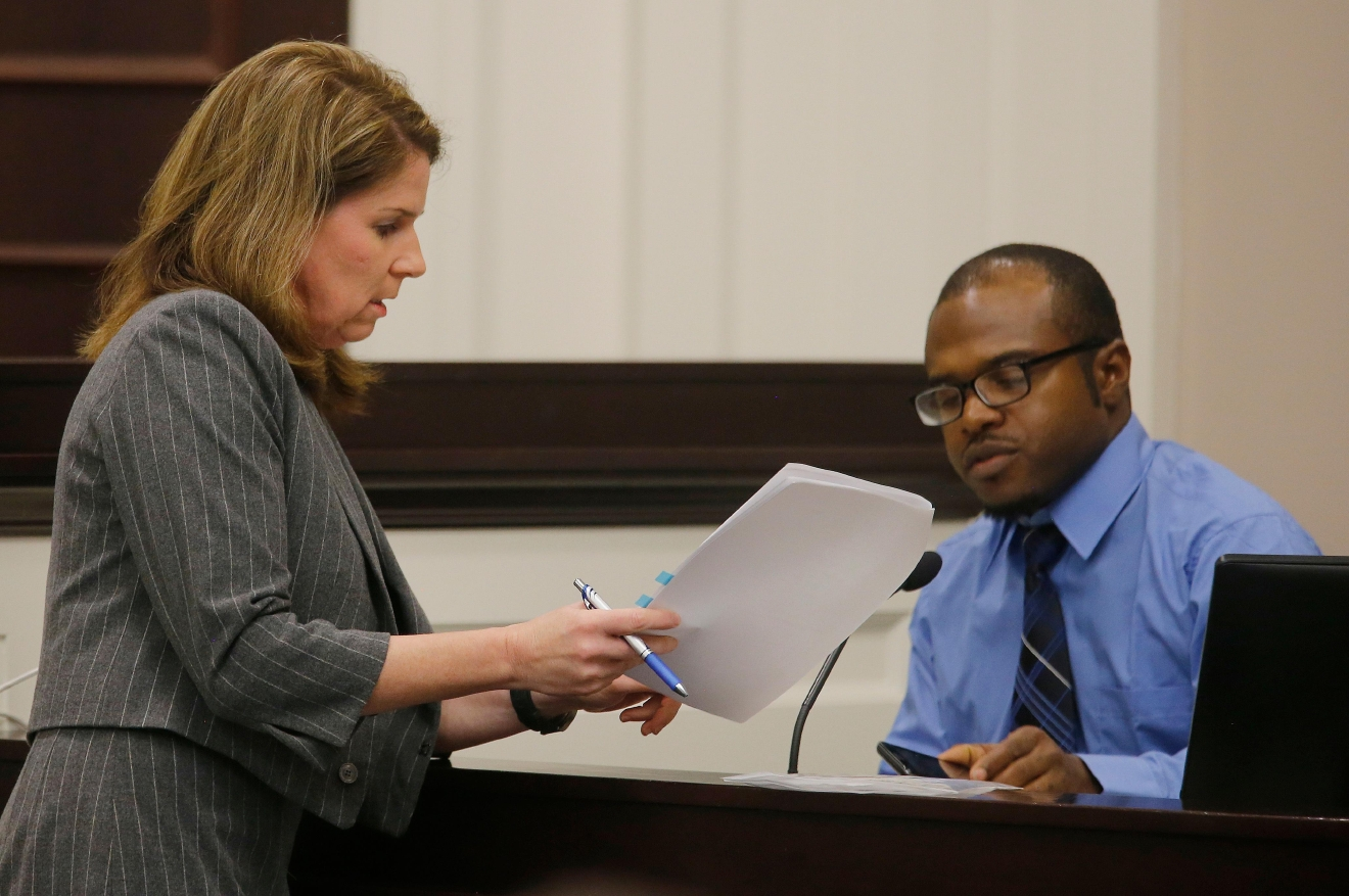 Pierre Fulton, who was in Walter Scott's vehicle when Scott was confronted by North Charleston Police Officer Michael Slager, speaks to Ninth Circuit Solicitor Scarlett Wilson during the trial of Slager, Thursday, Nov. 3, 2016 in Charleston, S.C. (Grace Beahm/Post and Courier via AP, Pool, File)